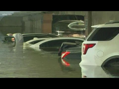 Tons of cars are underwater at the Dallas airport due to