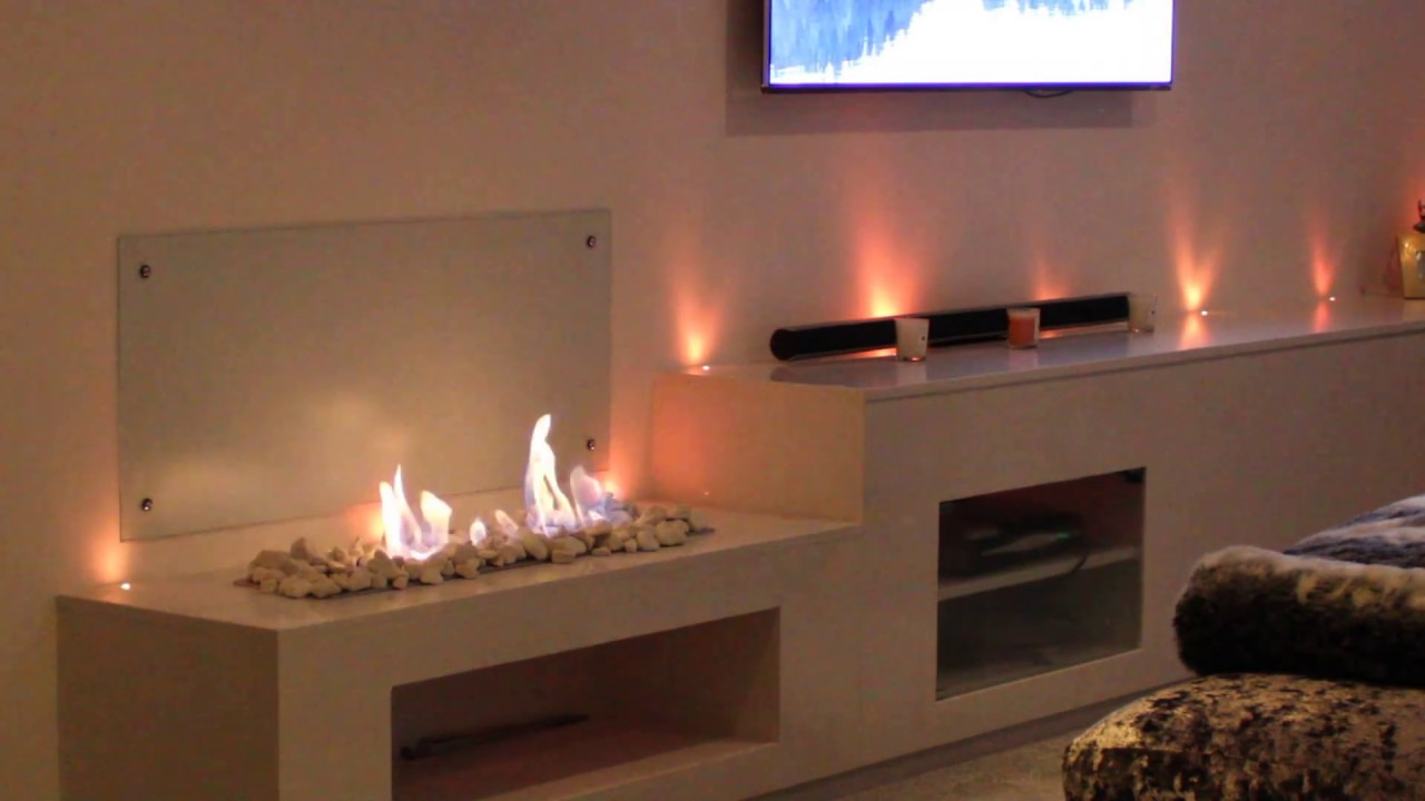 bespoke marble entertainment unit with gel fire and fibre optic