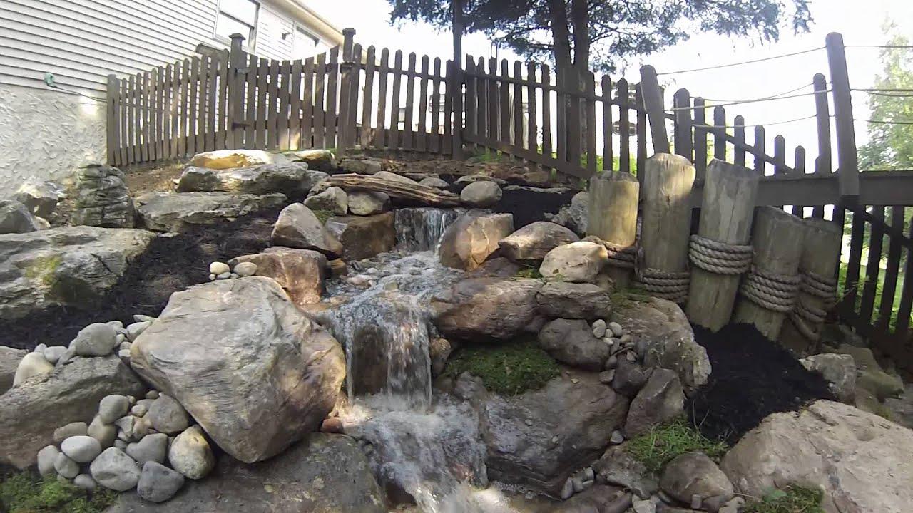 pondless waterfall natural stone steps boulder retaining wall