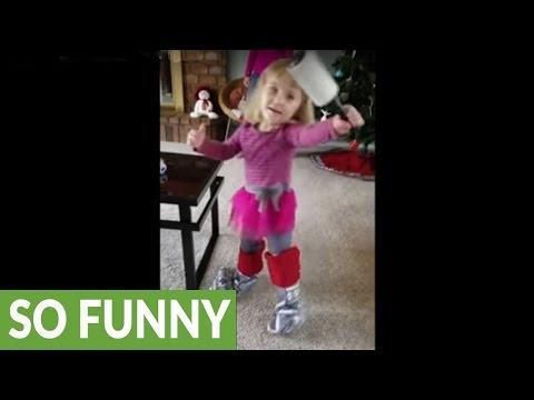 Toddler wears Christmas stockings on her feet