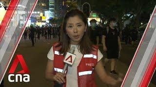 Shops close in popular Hong Kong shopping district as protesters defy China warnings