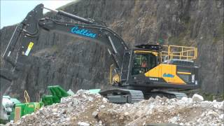 volvo ec380el excavator loading a crusher