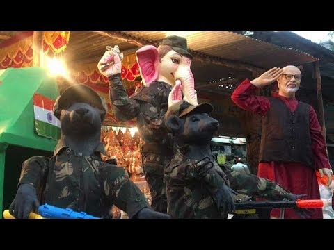 In a new avatar: Ganesha dressed in military camouflage, mice with AK-47s