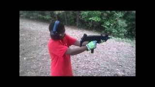 DezMan shooting an UZI 9mm