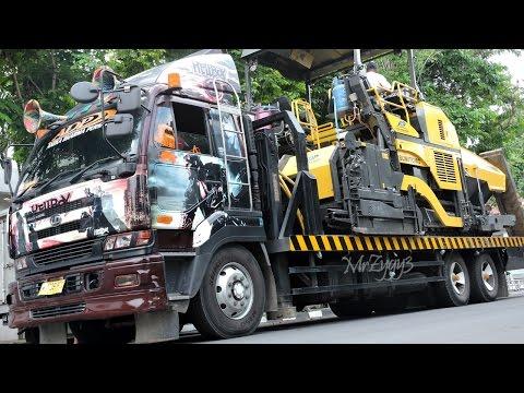 Asphalt Paver Working Sumitomo HA60C Nissan Self Loader Truck