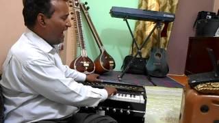 Learn Harmonium Online Guru Indian classical music training Free videos online Harmonium players