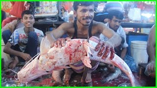 "Fishmonger Fish Cut Into Pieces By Knife (Bengali Name ""Boti"") Fish Cutting in Fish Market"