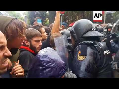 Tensions high as police hold back people outside Barcelona polling station