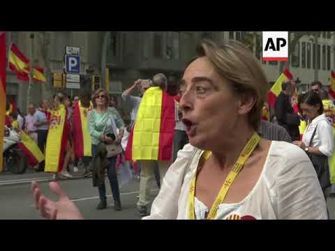 Hundreds march for unity in Barcelona on Spain's National Day