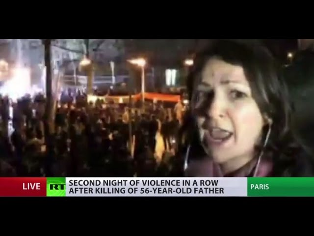 Police shoot tear gas at anti-brutality protesters in Paris during RT's live broadcast