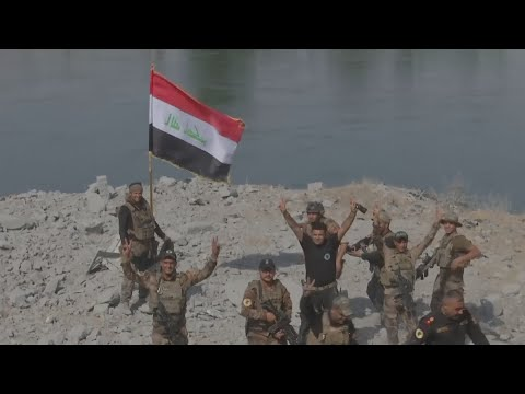 Iraqi troops celebrate the liberation of Mosul