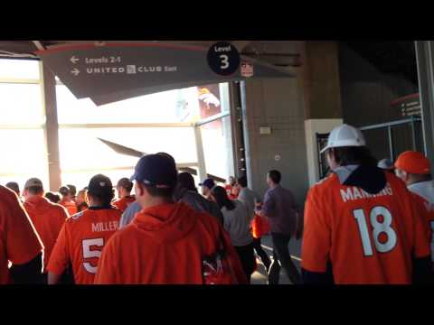Excited fans in Mile High Stadium after the Broncos defeat the Patriots on 1/19/14