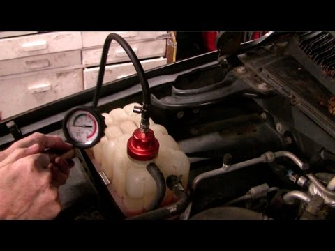 How to replace a water pump, coolant leak in a 2000 Chev GMC Suburban Truck  Part I