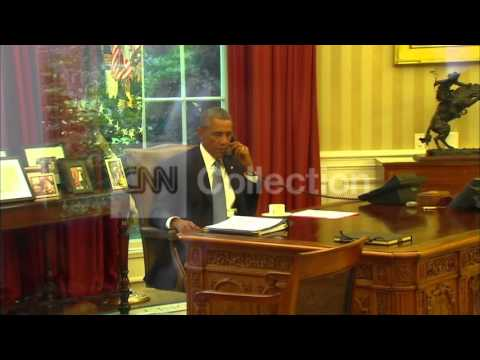 PRESIDENT OBAMA ON THE PHONE IN OVAL OFFICE