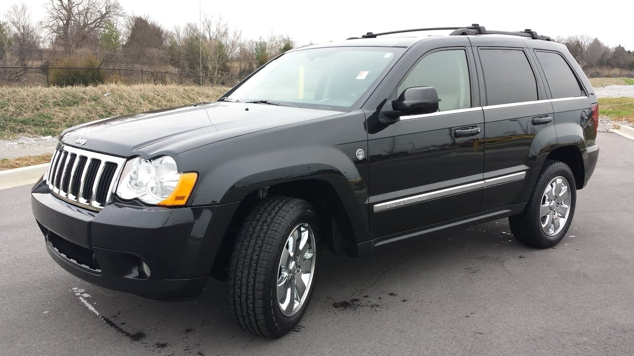 sold.2009 jeep grand cherokee limited 4x4 5.7 hemi 94k black with