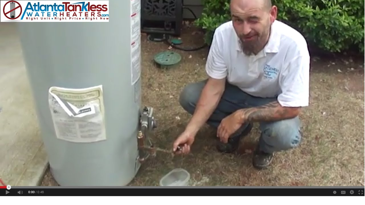 tankless water heater reviews atlanta plumber shows hot water heater debris build up inside tank youtube