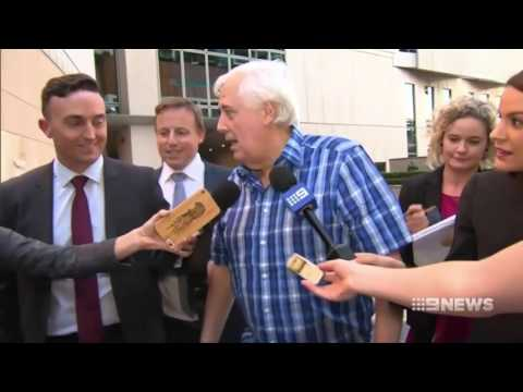 Clive Palmer tells media he's off for a surf after his court appearance