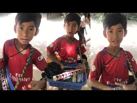 Young souvenir seller shows off linguistic skills