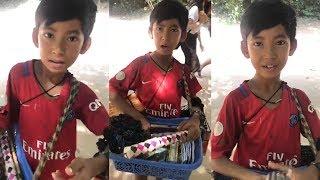 Young souvenir seller shows off linguistic skills