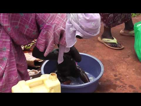 Little Christianar (Baby Brendah) gets a bath at hospital in Jinja_Uganda, Africa
