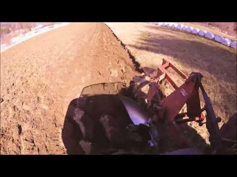 New Holland TN70 Pulling Three Bottom Ford 101 Plows