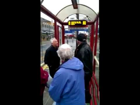 Old people argue in bus shelter
