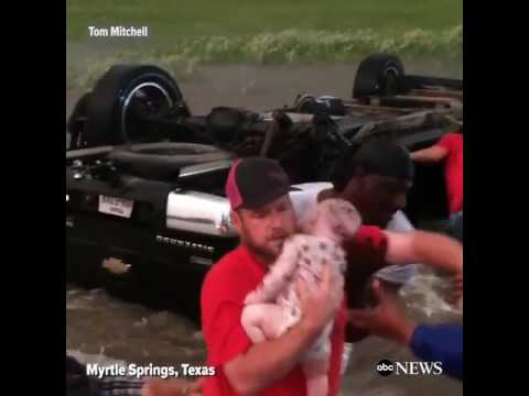 Good Samaritans rescuing infant from truck submerged in rushing Texas floodwaters