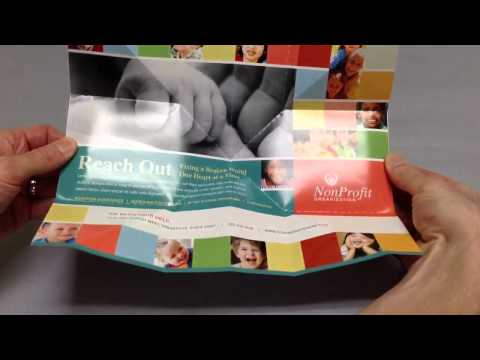 Exploding Page Direct Mail Design - Reach Out