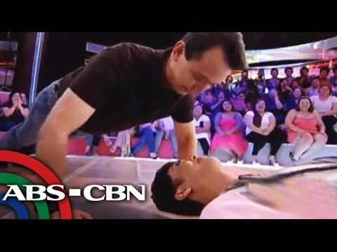 Sen. Trillanes does push-ups over Vice Ganda