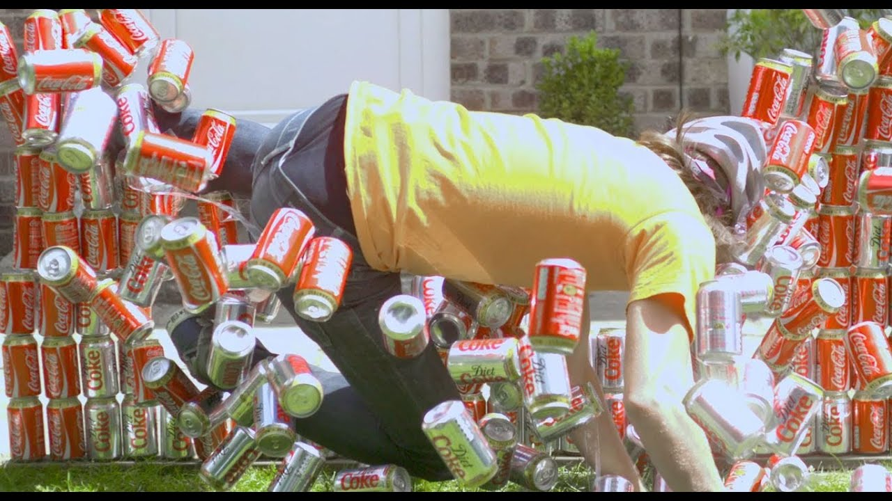 Crashing through 200 Coke Cans - The Slow Mo Guys