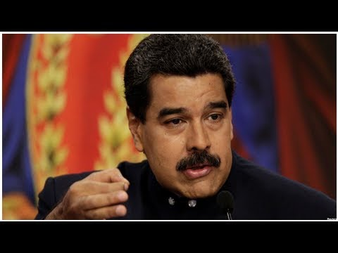 Venezuela looks to restructure debt, but default looms