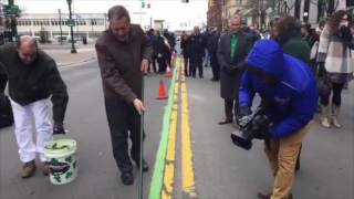 Green stripe painted along Syracuse St. Patrick's Parade route