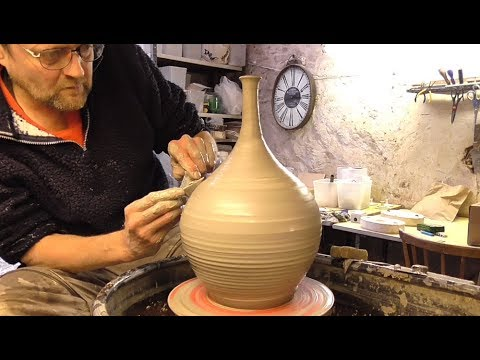 Making / Throwing a Tall Neck Pottery Vase on the Wheel.