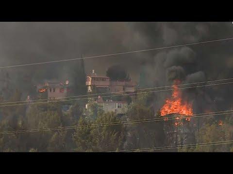 תושבים מפונים ובתים שרופים: היום השני של גל השריפות