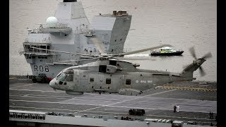 Royal Navy helicopter squadron practice skills ahead of arrival HMS Queen Elizabeth to home port