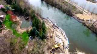 Pedestrian Bridge Construction For Greenbelt Next To Rivers Bend