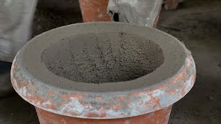 Shot of an Indian potter making cement planter (Gamla) with float and trowel