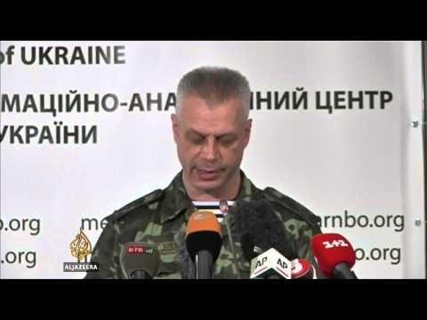 Ukraine says rebels shot down fighter jet