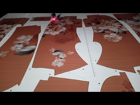 laser cutting sublimated garment fabric with printed registration marks