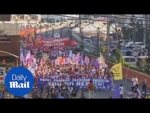 Activists in Manila in International Women's Day protest - Daily Mail