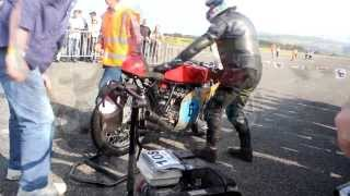 Honda 6 RC166 start up at Jurby festival Isle of Man during the Manx Grand Prix Classic TT