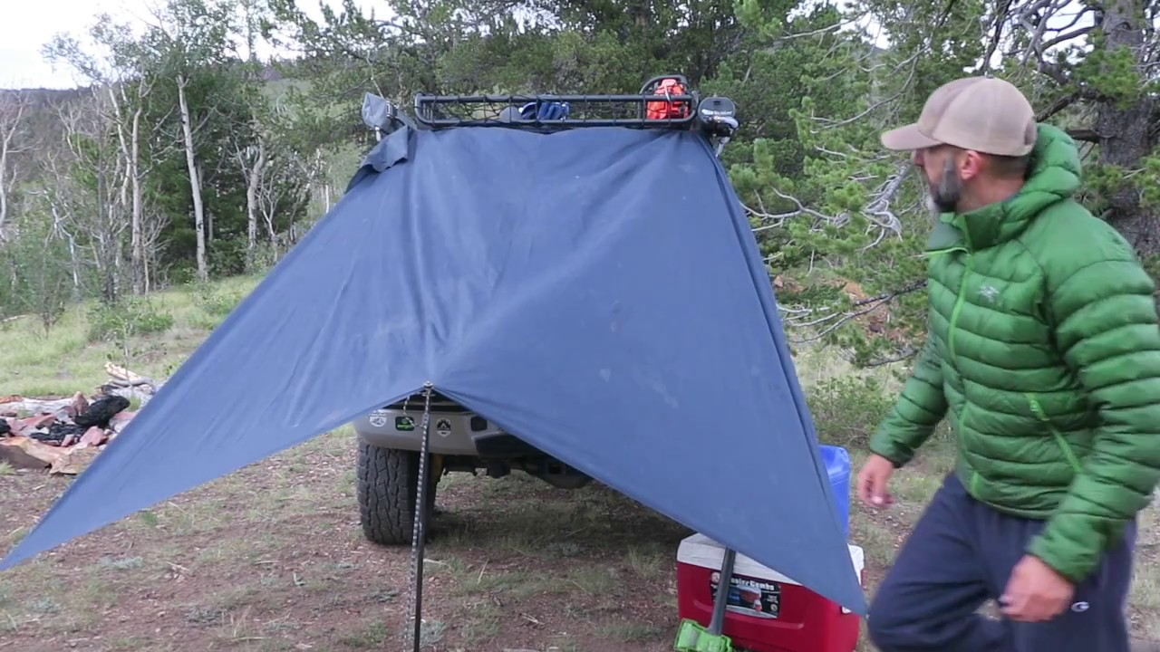 Truck Camping Setting Up Your Rain Tarp Using A Hiking Pole Instead Of Trees