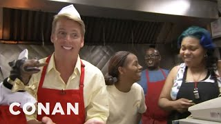 CONAN highlight: Jack McBrayer & Triumph the Insult Comic Dog pay a visit to Chicago's infamously hostile hot dog stand.