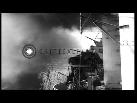 A destroyer escort and a Patrol Torpedo Boat lay a smoke screen as a convoy of sh...HD Stock Footage