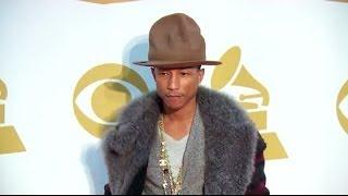 Pharrell Williams Auctions Off Hat For Charity | Splash News TV | Splash News TV