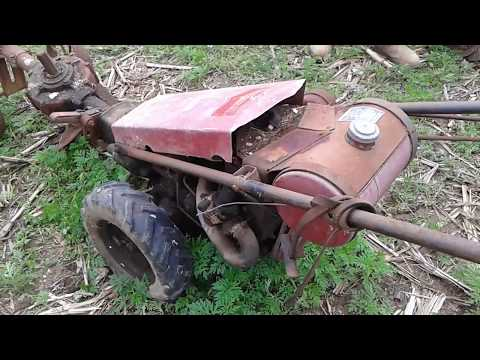 3 Gravely L tractors at a farm auction