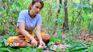 Beautiful girl cooking in forest and eating delicious