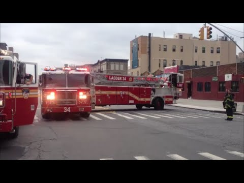 FDNY Tiller Ladder 34 Taking Up From A High Rise Fire In Harlem With Cool Tiller Maneuvers