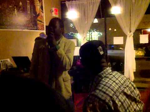 "Man killing James Brown's ""Living in America"" @ karaoke"
