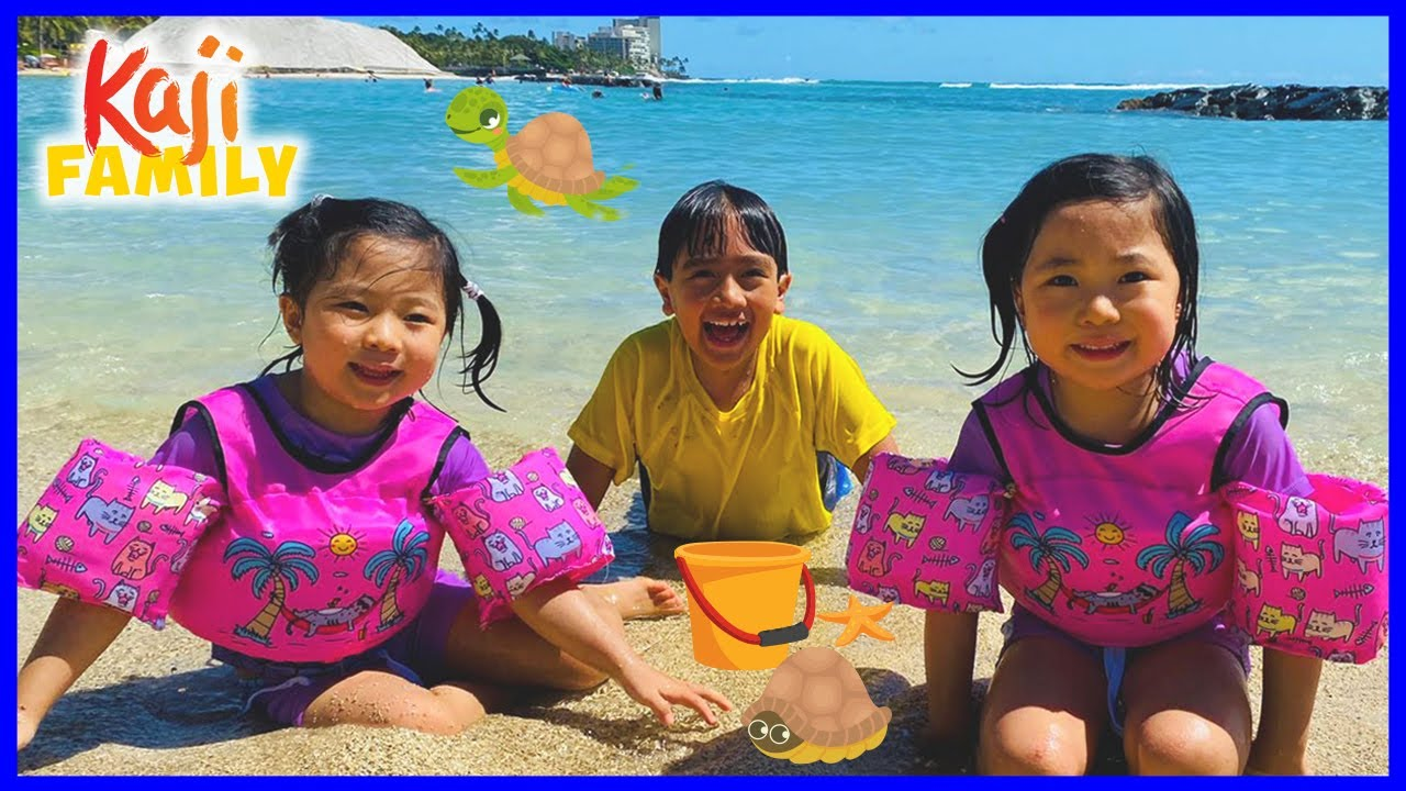 Family Fun at the Beach in Hawaii and playing in the sand!